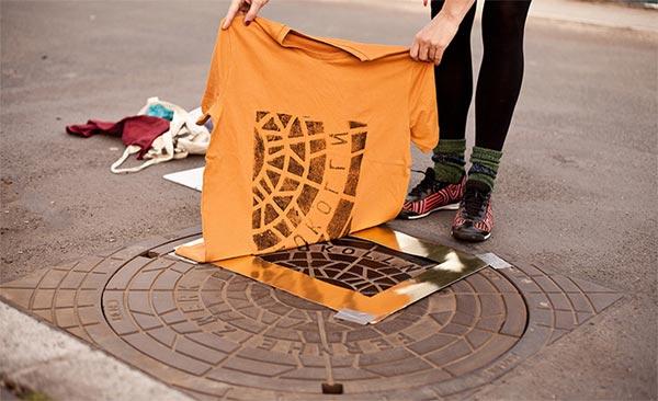 Street Printing plaques égouts imprimées sur Tee-shirts